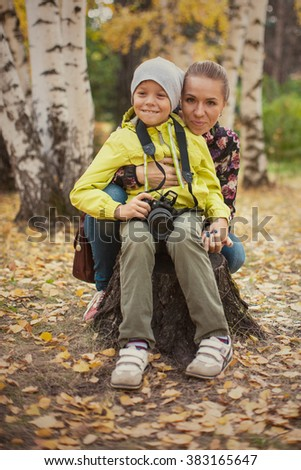 Woman and her son with camera