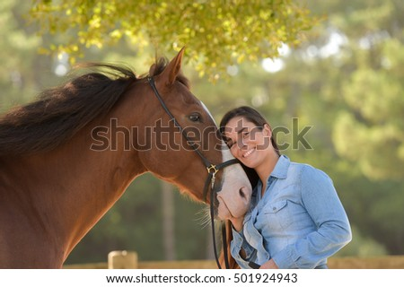 Woman and his horse, equestrian center, France