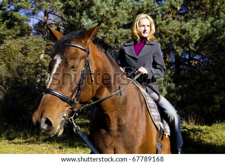 Woman and horse - stock photo