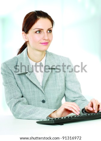woman and keyboard in the office - stock photo