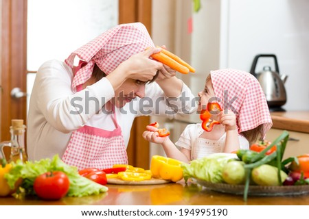 woman and kid girl cooking and having fun - stock photo