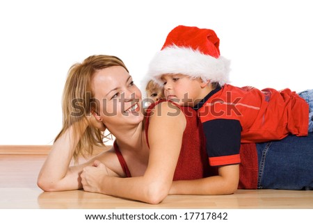 Woman and kids with santa hats at christmas time - isolated