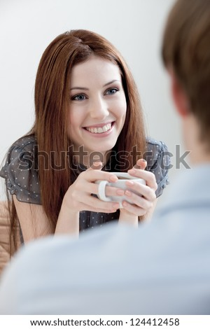 Woman and man are sitting at the cafe - stock photo