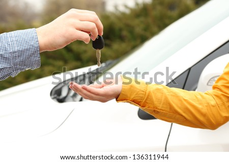 Woman and man hands with car key, close up - stock photo