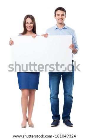Woman and man holding a placard  - stock photo