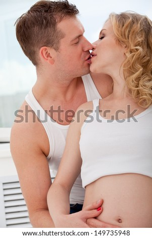 woman and man kissing - stock photo
