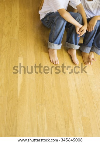 woman and man on the wood floor - stock photo