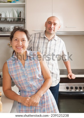 Woman and man standing in kitchen