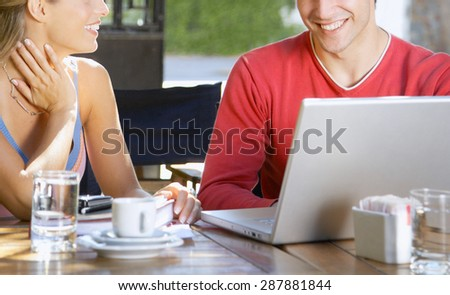 woman and man working on laptop - stock photo