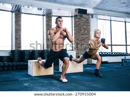 Woman and man working out with fit box at gym - stock photo