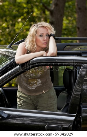 woman and off road car