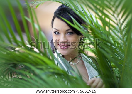 Woman and palm-tree - stock photo