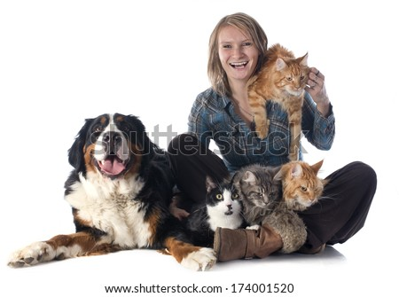 woman and pet in front of white background - stock photo
