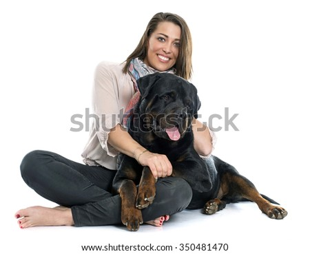 woman and rottweiler in front of white background