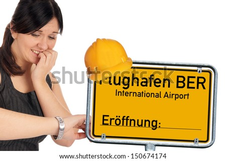 Woman and shield with the german words Berlin Brandenburg Airport / BBI airport - stock photo