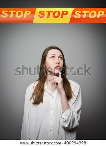 Woman and STOP line over her head. Restricted area concept. - stock photo