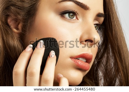 woman apply a sponge egg foundation