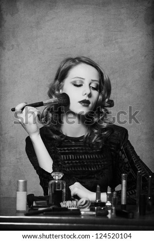 Woman applying cosmetics