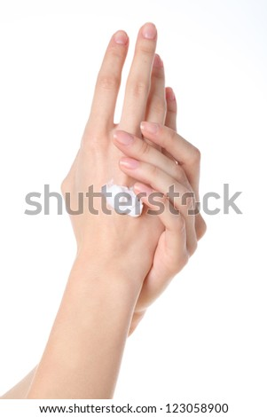 Woman applying cream to her hands, isolated - stock photo