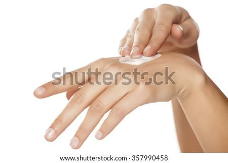 Woman applying hand cream - stock photo