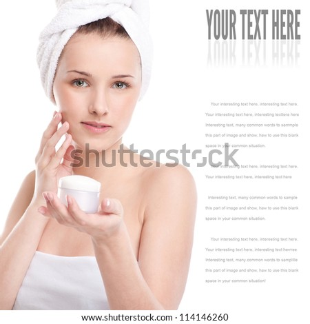 Woman applying moisturizer cream on face. Close-up fresh woman face isolated on white - stock photo