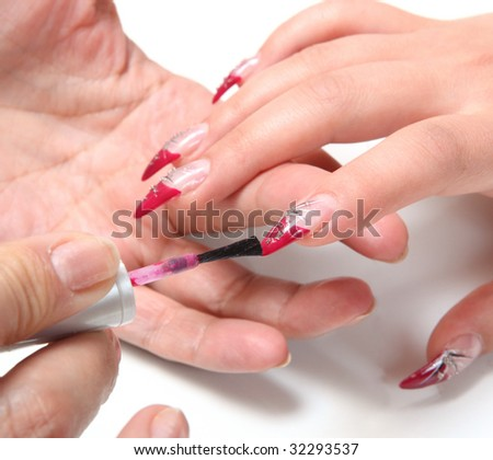 Woman applying red nail polish