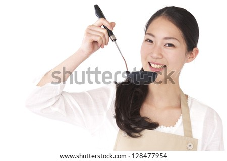 Woman apron with a ladle - stock photo