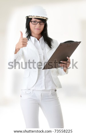 Woman architects in white helmet - stock photo