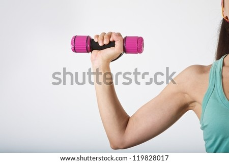 woman arm at gym lifting dumbbells over white background