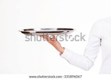 Woman arm in waiter uniform holding tray. Over white background.