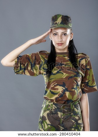 Woman army soldier saluting isolated on gray background