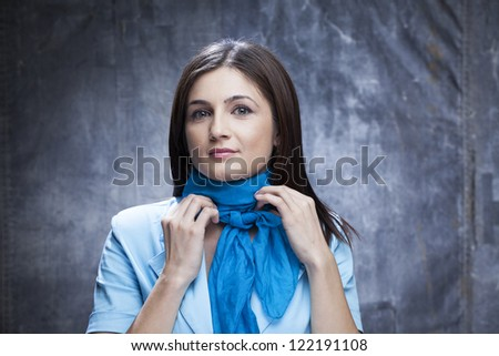woman arranging scarf