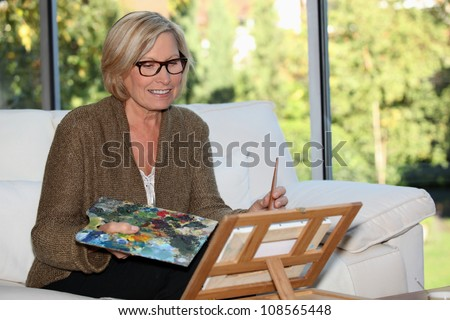 Woman artist at home - stock photo
