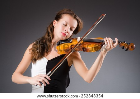 Woman artist with violin in music concept - stock photo