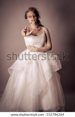 Woman as a Zombie Bride studio portrait - stock photo