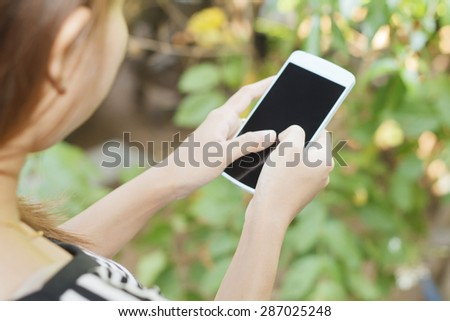 Woman asia using smart phone - stock photo
