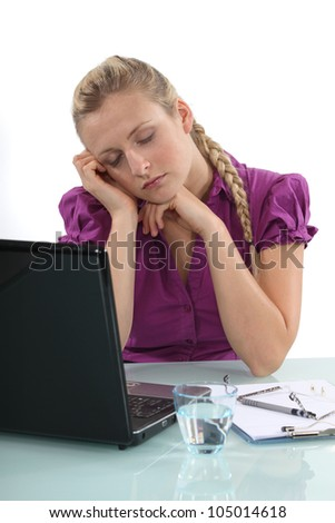 Woman asleep at her laptop