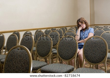 Woman at a boring conference - stock photo