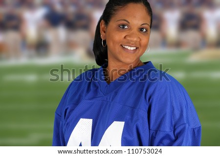 Woman at a football game cheering for her team