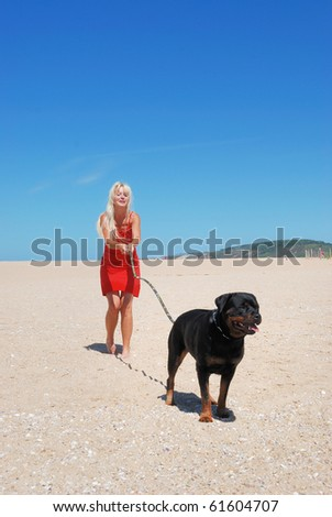 woman at beach with dog