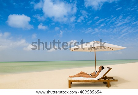 Woman at beautiful beach relax at the chair - stock photo