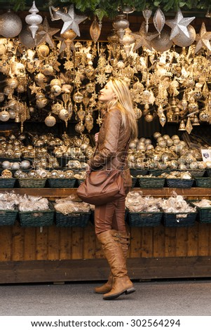 woman at Christmas market, Vienna, Austria - stock photo