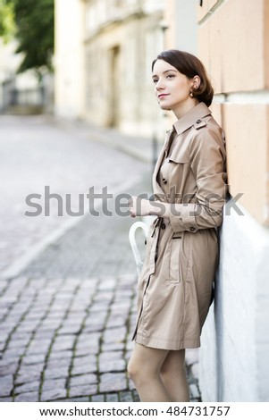 Woman at coat observe actions on street