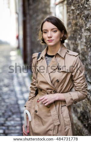 Woman at coat thinking where to go