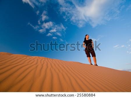 Woman at Coral Pink Sand Dunes, Utah - stock photo
