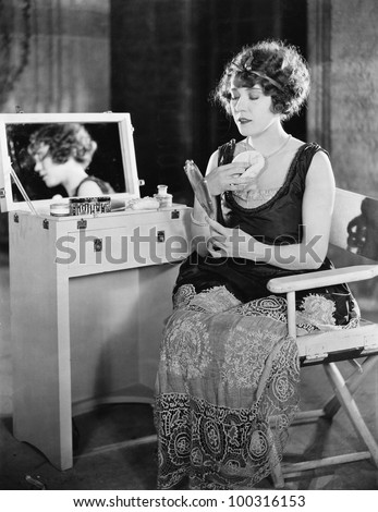 Woman at dressing table