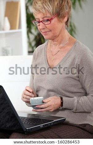 Woman at home with laptop