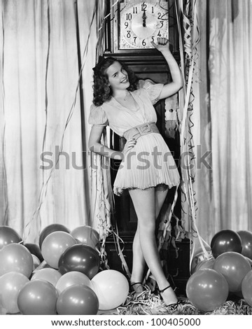 Woman at midnight on New Years Eve - stock photo