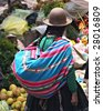 Woman at Pisac Market in Peru - stock photo