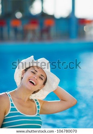 Woman at pool bar enjoying vacation - stock photo